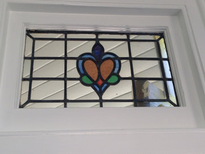 The best way to make stained glass pop? White painted window frames.
