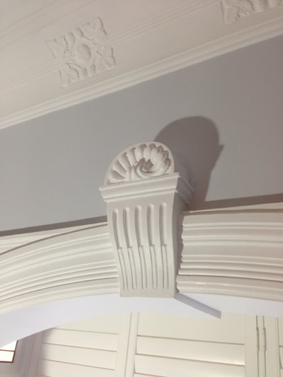 Moulded plaster decorations look best painted white - flat or low sheen.