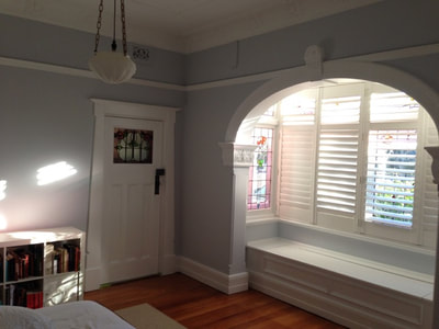 Grey walls, white trim and ceiling, and warm timber floors.
